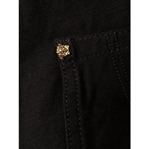 Jeans con placca con logo Medusa